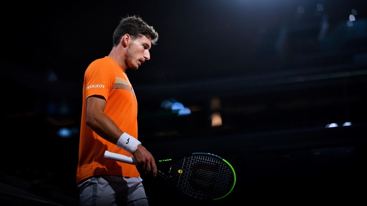 Spain's Pablo Carreno Busta reacts as he plays against Serbia's Novak Djokovic during their men's singles quarter-final tennis match on Day 11 of The Roland Garros 2020 French Open tennis tournament in Paris on October 7, 2020