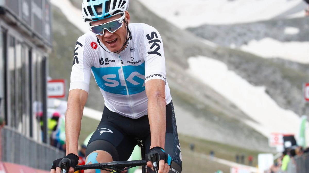 Chris Froome reacts after crossing the finish line of the 9th stage