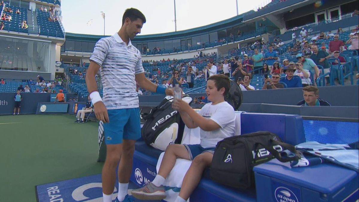 Djokovic takes care of a boy before his match