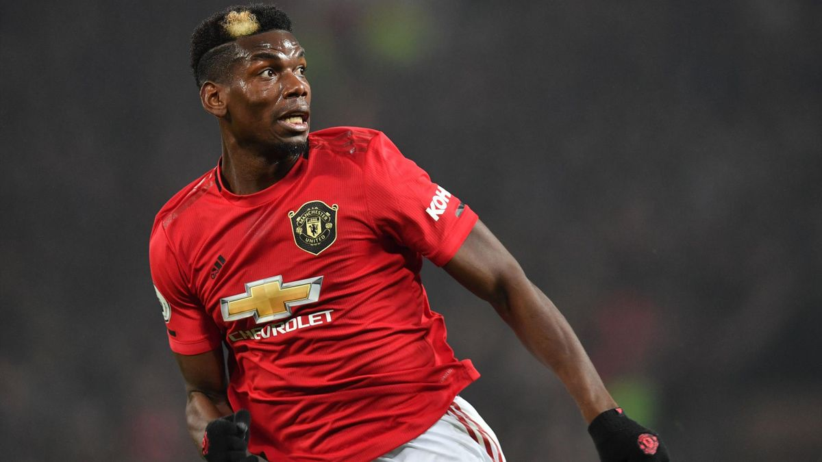 Manchester United's French midfielder Paul Pogba makes a run during the English Premier League football match against Newcastle United at Old Trafford in Manchester, on December 26, 2019.