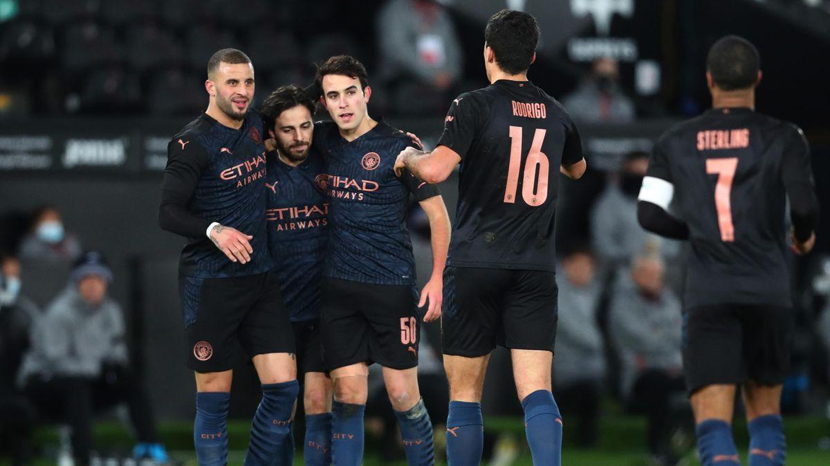 Les joueurs de Manchester City fêtent le but de Kyle Walker lors du match opposant Swansea à Manchester City, en FA Cup, le 10 février 2021