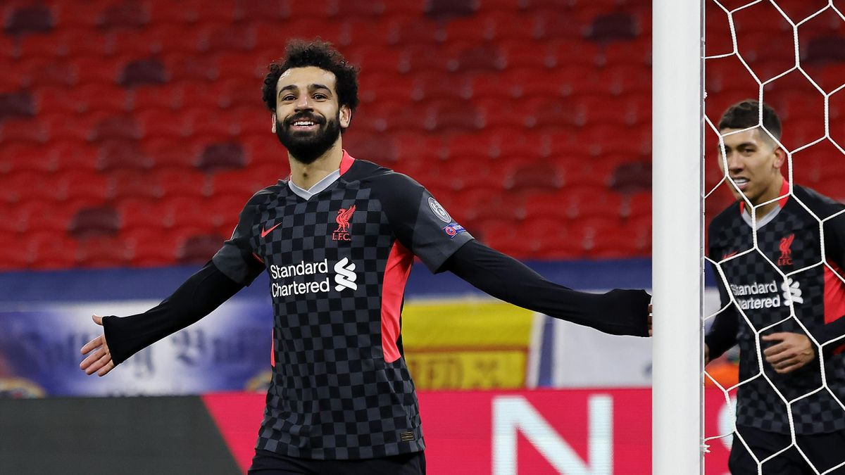 Mohamed Salah of Liverpool celebrates after scoring their side's first goal during the UEFA Champions League Round of 16 match between RB Leipzig and Liverpool FC at Puskas Arena on February 16, 2021 in Budapest, Hungary