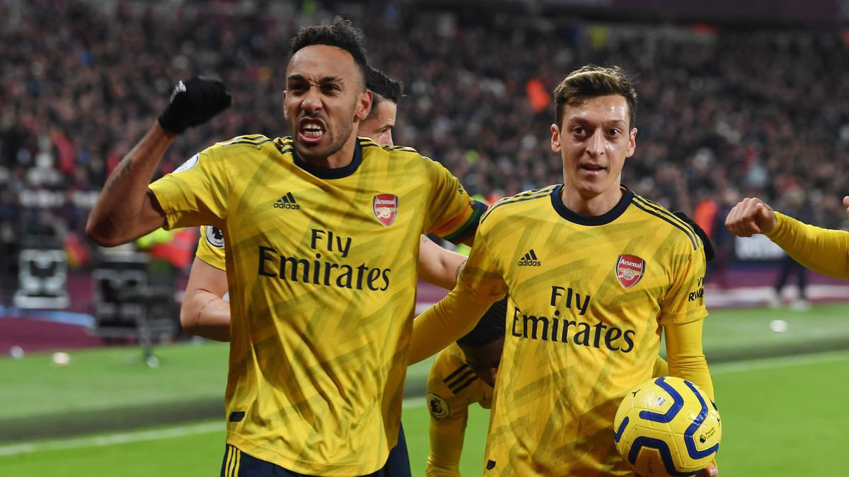 Pierre-Emerick Aubameyang celebrates the 2nd Arsenal goal with (R) Mesut Ozil during the Premier League match between West Ham United and Arsenal FC at London Stadium on December 09, 2019