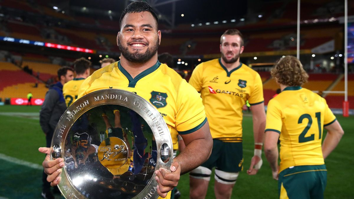 Taniela Tupou of the Wallabies poses with the Mandela Plate after winning The Rugby Championship match between the Australian Wallabies and the South Africa Springboks .