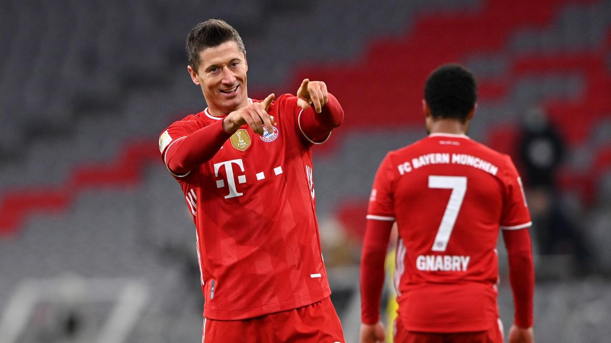 Robert Lewandowski of FC Bayern Muenchen celebrates after scoring their side's fourth goal, completing his hat-trick during the Bundesliga match between FC Bayern Muenchen and Borussia Dortmund at Allianz Arena on March 06, 2021 in Munich, Germany