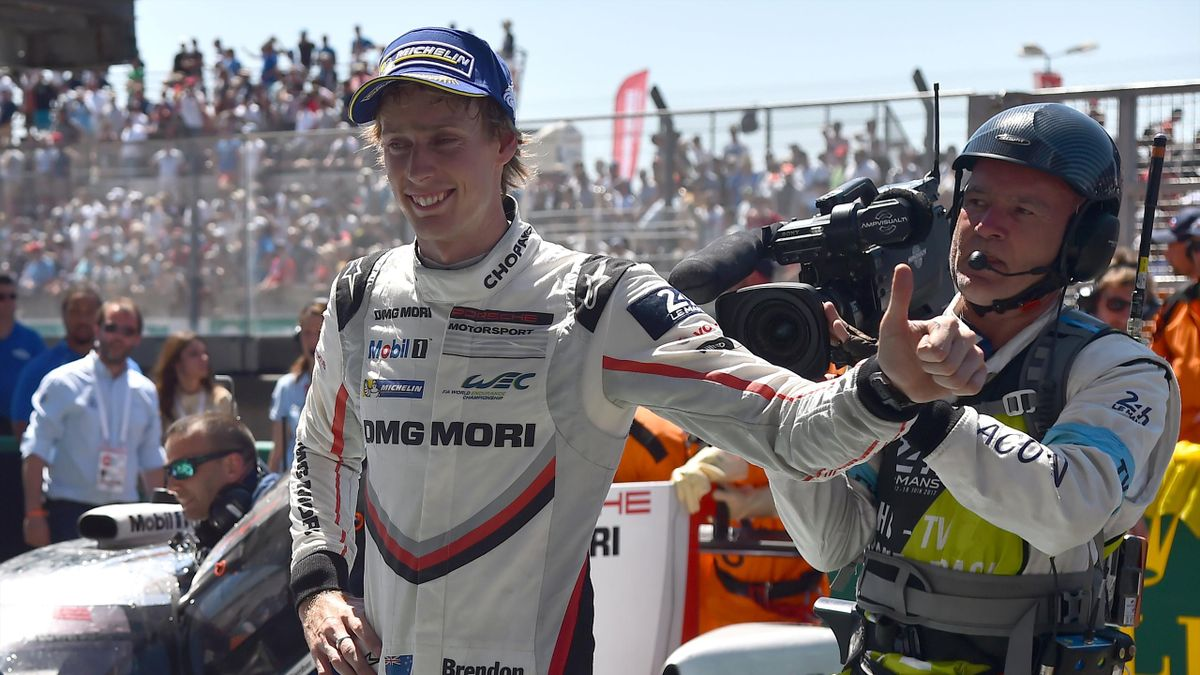 New Zeland's driver Brendon Hartley (Porsche 919 Hybrid N°2) celebrates after winning the 85th Le Mans 24-hours endurance race on June 18, 2017 in Le Mans, western France. Timo Bernhard steered Porsche to a 19th Le Mans title in a gripping 85th edition of