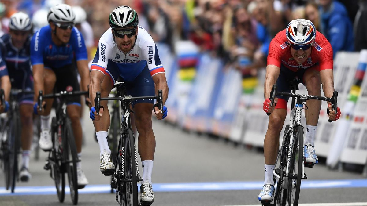 Slovak Peter Sagan (C) crosses the finish line ahead of Norwegian Alexander Kristoff (R) during the men elite road race of the UCI Cycling Road World Championships in Bergen, on September 24, 2017.