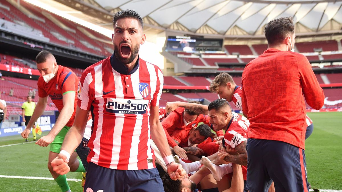 Yannick Carrasco of Atletico Madrid celebrates Atletico de Madrid's second goal scored by Luis Suarez (not pictured) during the La Liga Santander match between Atletico de Madrid and C.A. Osasuna at Estadio Wanda Metropolitano on May 16, 2021 in Madrid, S