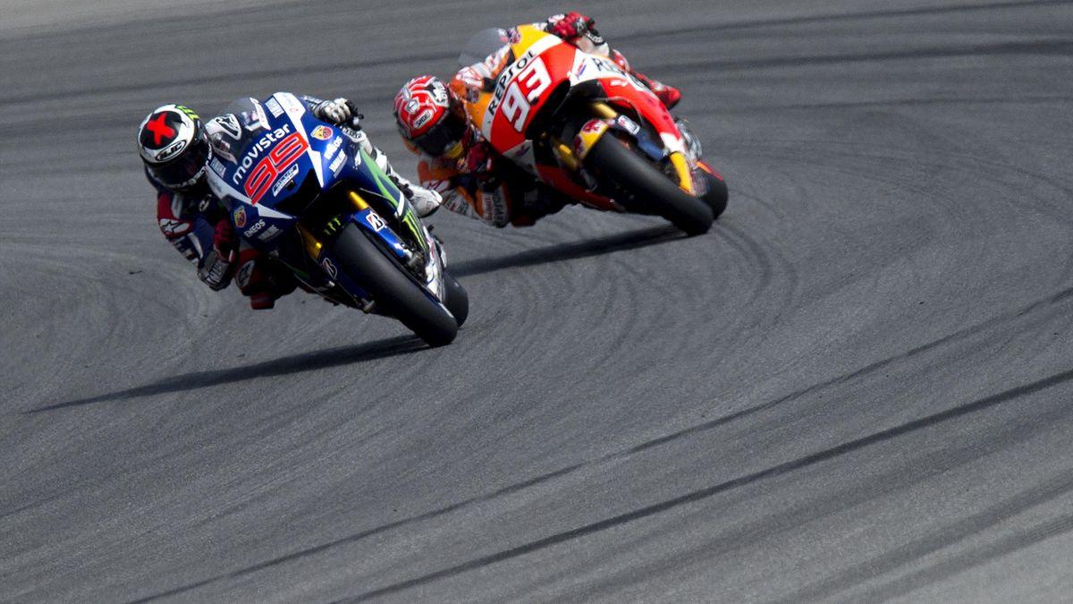 Yamaha MotoGP's Spanish rider Jorge Lorenzo (L) and Repsol Honda Team's Spanish rider Marc Marquez compete during the Moto GP Czech Grand Prix in Brno, Czech Republic, on August 16, 2015