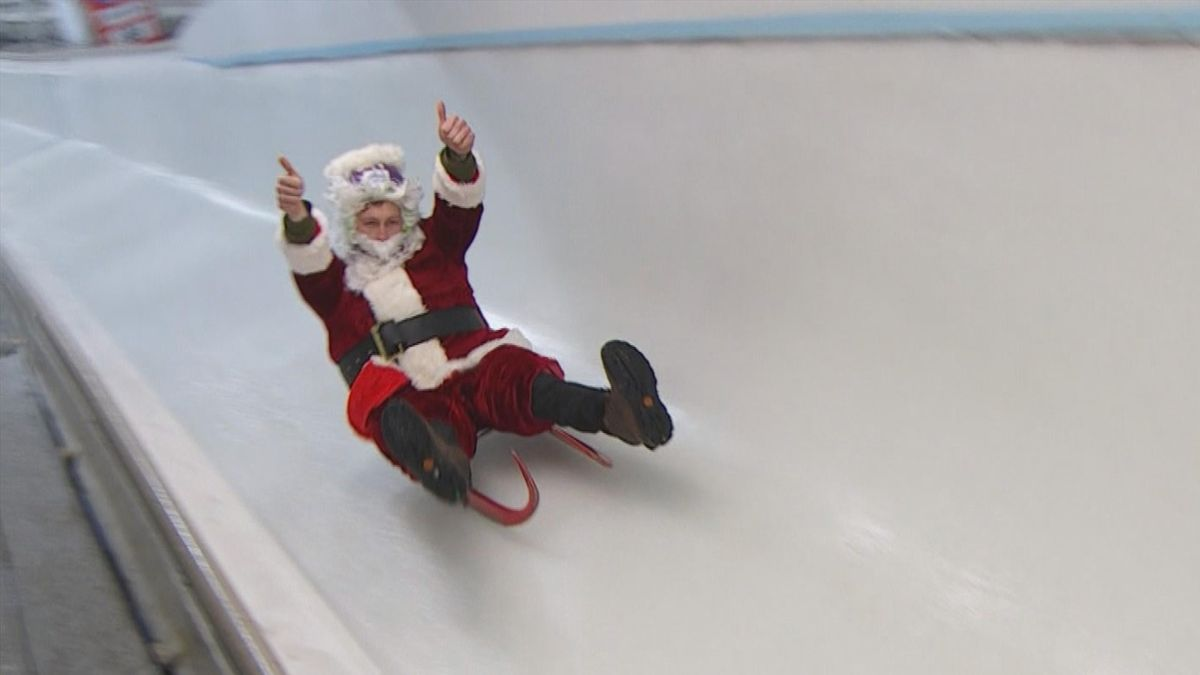 Santa Claus does some luge