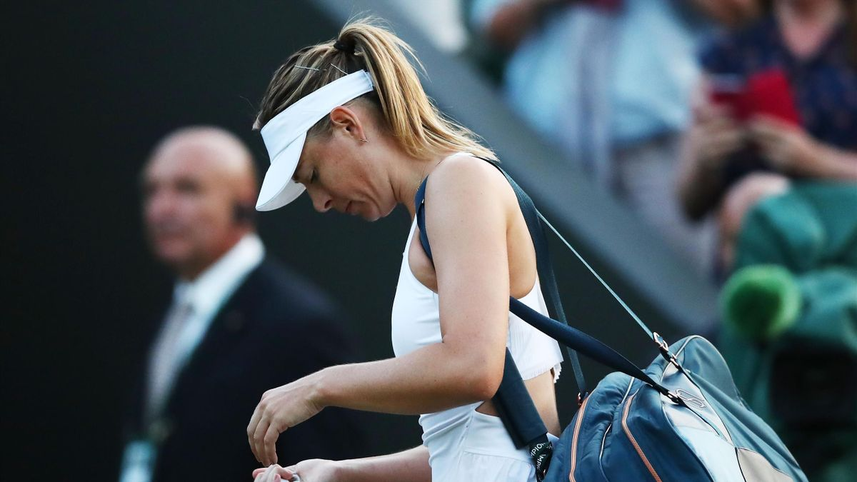 Maria Sharapova of Russia appears dejected after her Ladies' Singles first round match against Vitalia Diatchenko of Russia on day two of the Wimbledon Lawn Tennis Championships