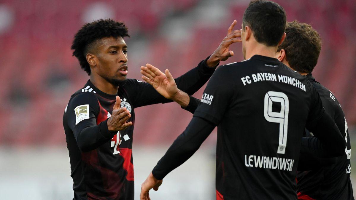 Kingsley Coman (l.) mit Bayern-Teamkollege Robert Lewandowski