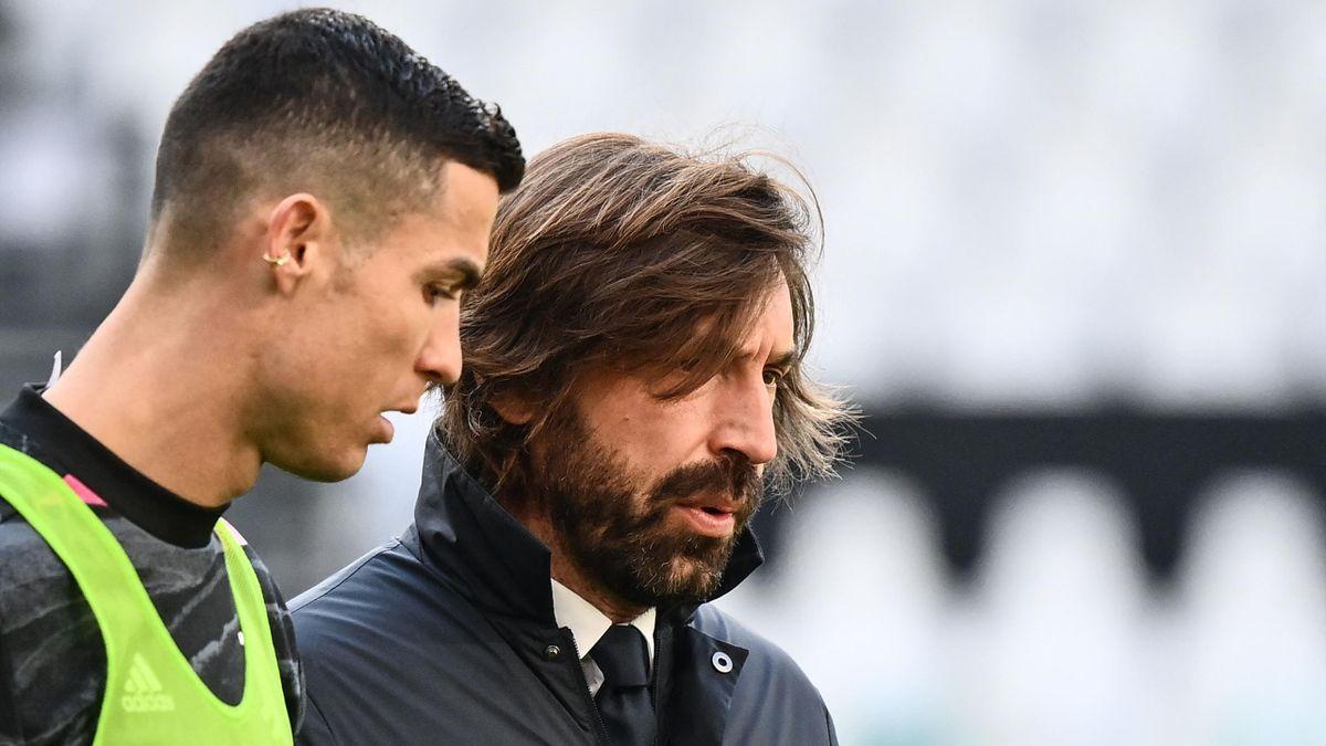 Cristiano Ronaldo (l.) mit Andrea Pirlo (r.)