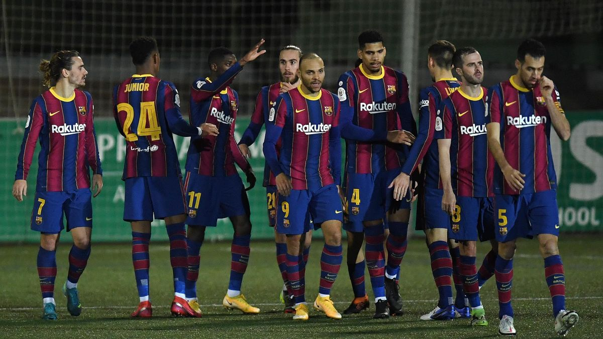 Ousmane Dembele of Barcelona celebrates with Martin Braithwaite, Ronald Araujo and team mates after scoring their side's first goal during the Copa del Rey match between Cornella and FC Barcelona on January 21, 2021 in Barcelona, Spain.