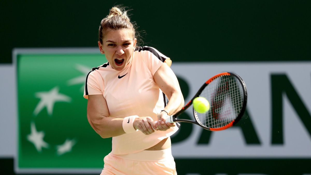 Simona Halep of Romania returns a shot to Petra Martic of Croatia during the BNP Paribas Open at the Indian Wells Tennis Garden on March 14, 2018 in Indian Wells, California.