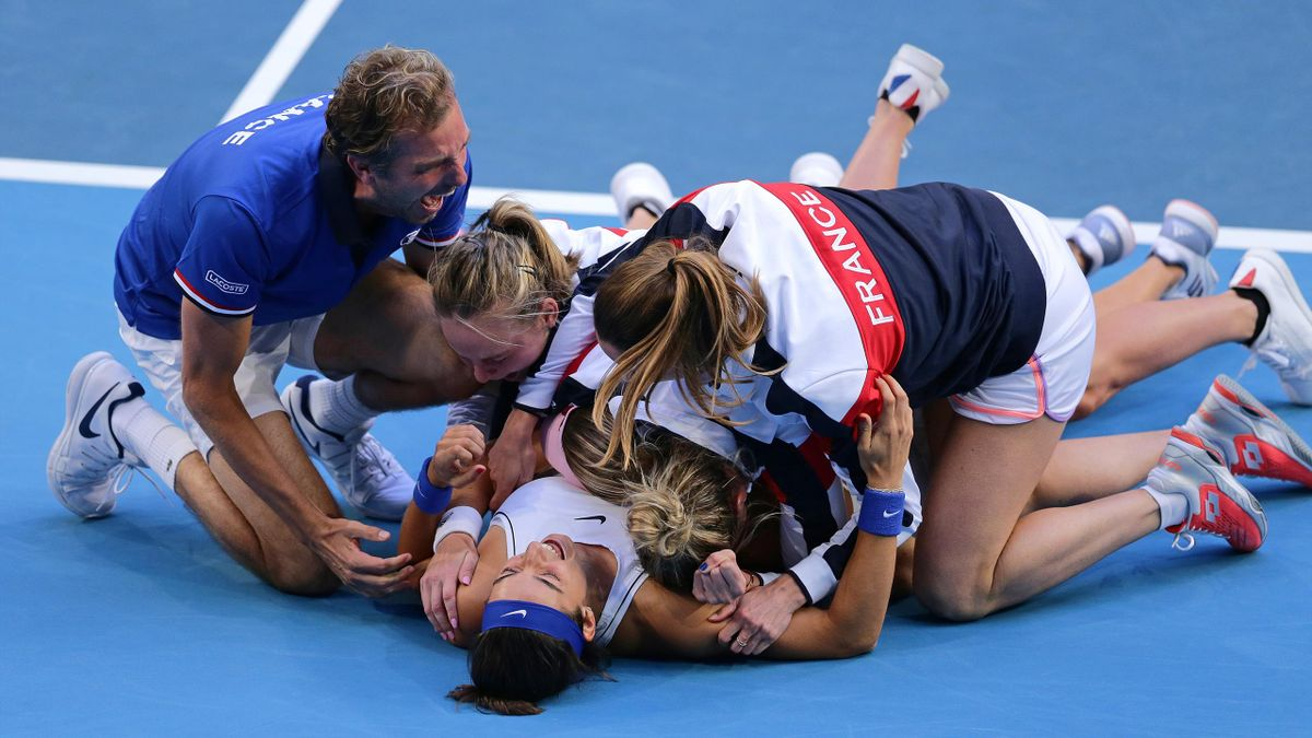 Caroline Garcia and Kristina Mladenovic of France celebrate after winning the Women's doubles match against Ash Barty and Sam Stosur of Australia in the 2019 Fed Cup Final tie between Australia and France at RAC Arena on November 10, 2019