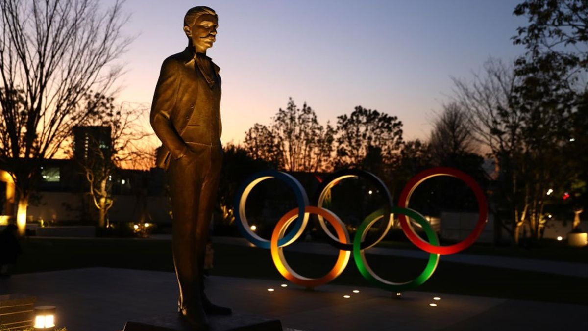 A monument in honor of Olympic founder Baron Pierre de Coubertin alongside the Olympic rings are seen outside the New National Stadium in Tokyo on January 21, 2020 in Tokyo, Japan