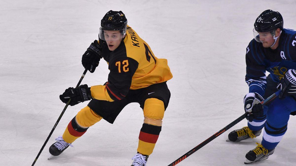 Eishockey bei Olympia 2018: Dominik Kahun (Deutschland) im Duell mit Petri Kontiola (Finnland)