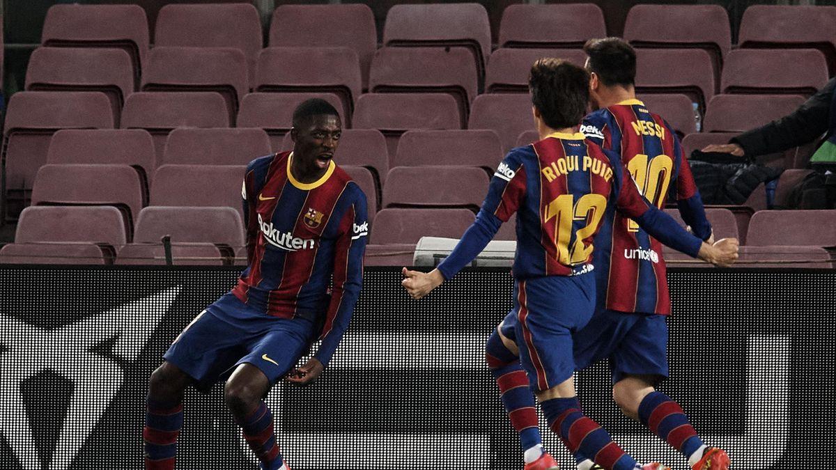 Ousmane Dembele of Barcelona celebrates after scoring his sides first goal during the La Liga Santander match between FC Barcelona and Real Valladolid CF at Camp Nou on April 5, 2021 in Barcelona, Spain.