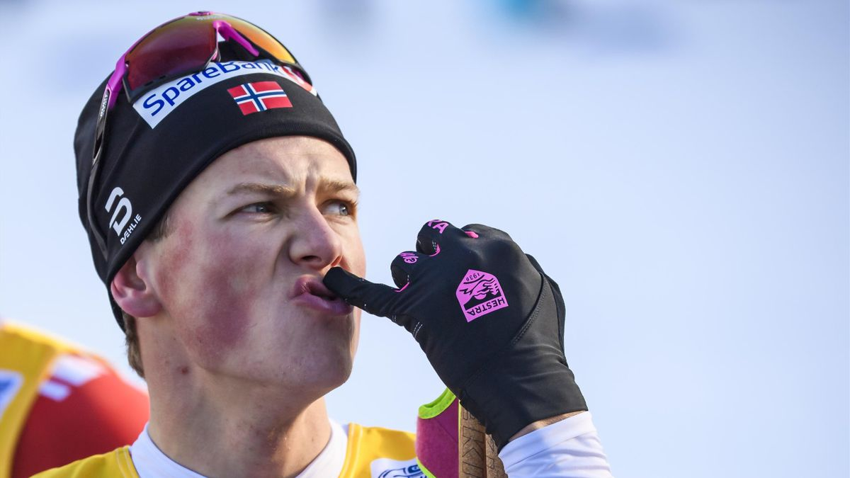 Johannes Hoesflot Klaebo of Norway at the finish after the Men's 15 km F Mst at the FIS Cross-Country World Cup Lenzerheide at on December 28, 2019 in Lenzerheide, Switzerland