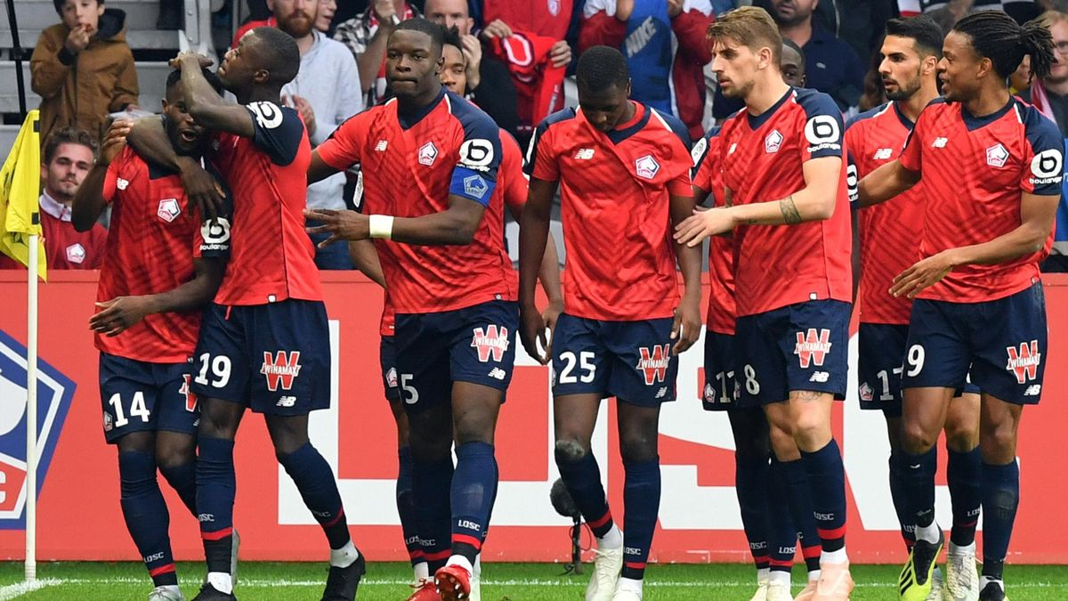Lille's French midefielder Jonathan Bamba (L) celebrates with Lille's Ivorian forward Nicolas Pepe (2ndL) after scoring during the French L1 football match between Lille OSC (LOSC) and Saint Etienne at the Pierre-Mauroy Stadium in Villeneuve d'Ascq, near