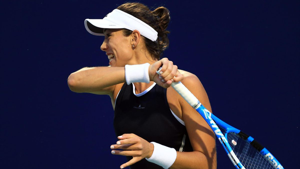 Garbine Muguruza of Spain plays a shot against Elina Svitolina of Ukraine during Day 7 of the Rogers Cup at Aviva Centre on August 11, 2017 in Toronto, Canada.