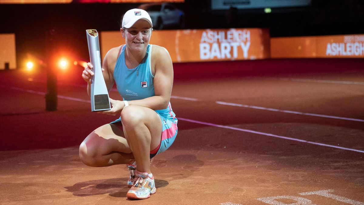 Winner Australia's Ashleigh Barty poses with her trophy after the singles final match against Belarus' Aryna Sabalenka (not in picture) of the Women's Tennis Grand Prix WTA 500 tournament in Stuttgart, southwestern Germany, on April 25, 2021