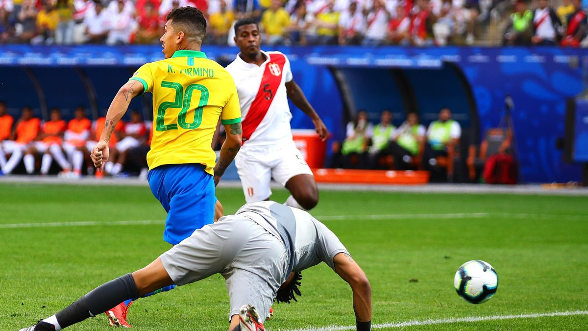 Roberto Firmino of Brazil scores his side's second goal during the Copa America Brazil 2019 group A match between Peru and Brazil at Arena Corinthians on June 22, 2019 in Sao Paulo, Brazil.