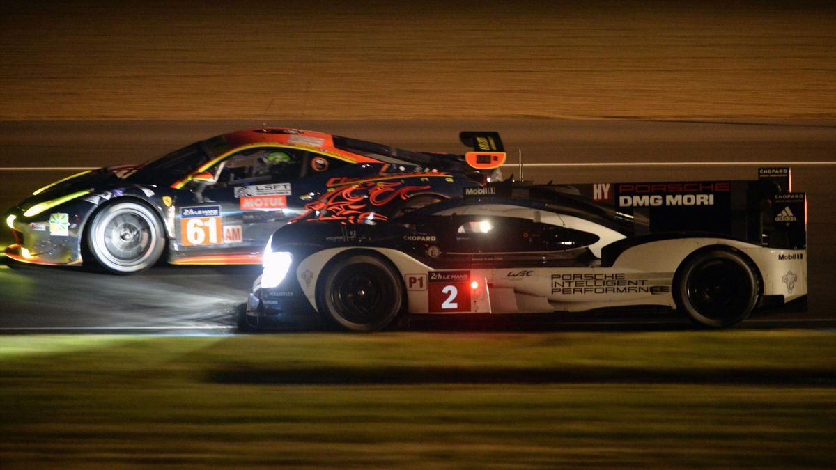 Switwzerland's Neel Jani (R) drives his Porsche 919 Hybrid N°2 during the first qualifying practice session of the 84th Le Mans 24 hours endurance race