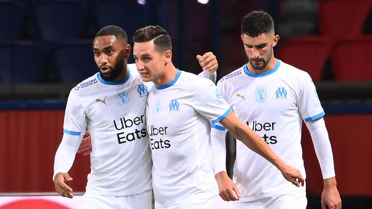 Florian Thauvin (C) celebrates after scoring
