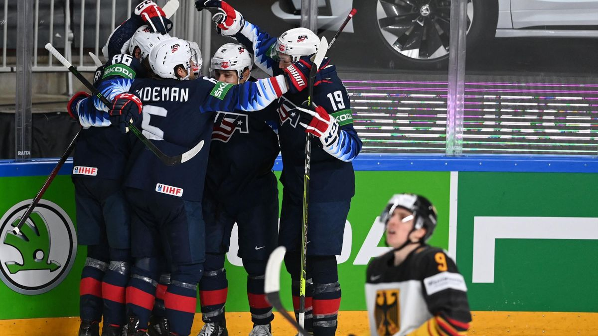 USA's players celebrate during the IIHF Men's Ice Hockey World Championships bronze medal match between the USA and Germany at the Arena Riga in Riga, Latvia, on June 6, 2021