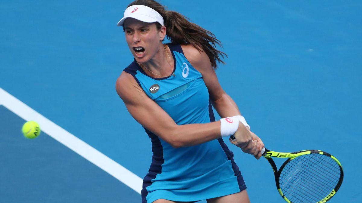 Johanna Konta of Britain hits a return against Daria Gavrilova of Australia during their women's singles second round match at the Sydney International.