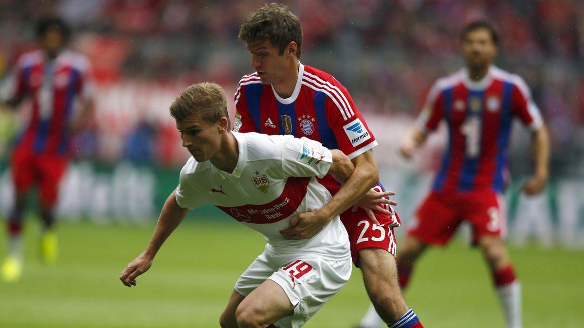 Bayern Munich's Thomas Mueller challenges VfB Stuttgart's Timo Werner (L)