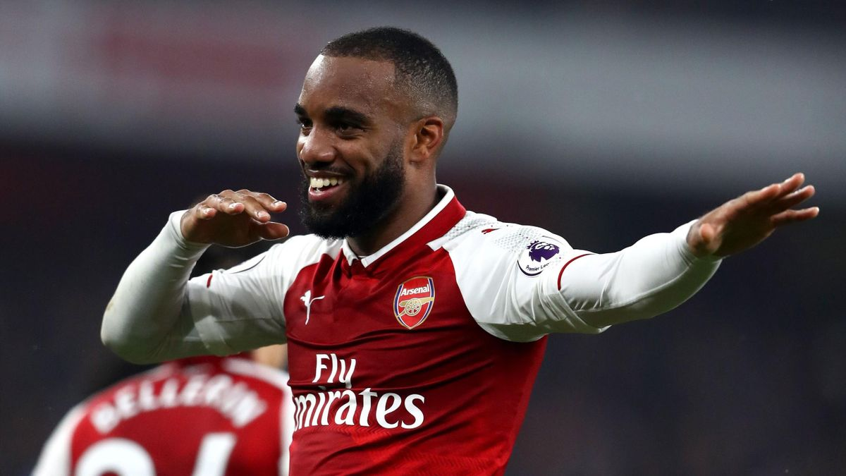 Alexandre Lacazette of Arsenal celebrates as he scores their second goal from a penalty during the Premier League match between Arsenal and West Bromwich Albion at Emirates Stadium