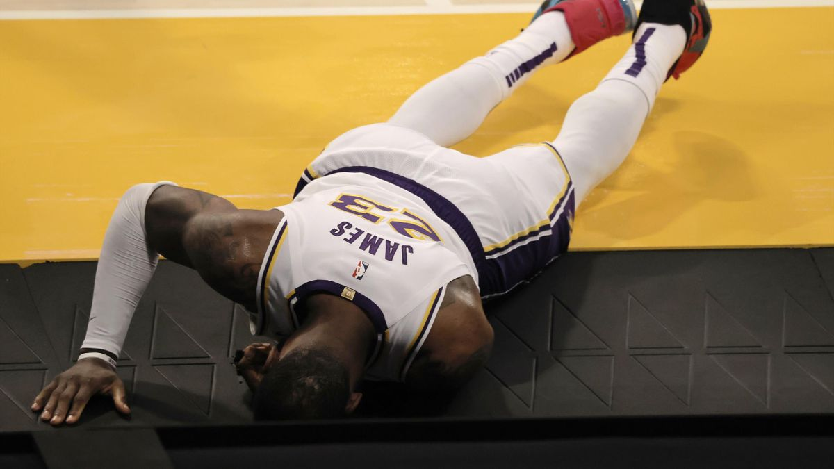 LeBron James #23 of the Los Angeles Lakers reacts to an apparent injury during the second period of a game against the Atlanta Hawks at Staples Center on March 20, 2021 in Los Angeles, California