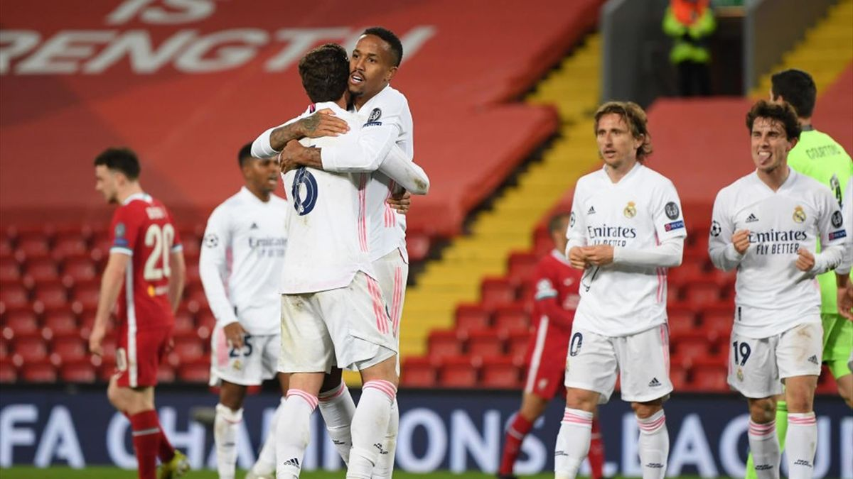 Eder Militao of Real Madrid celebrates victory with team mate Nacho following the UEFA Champions League Quarter Final Second Leg match between Liverpool FC and Real Madrid at Anfield on April 14, 2021