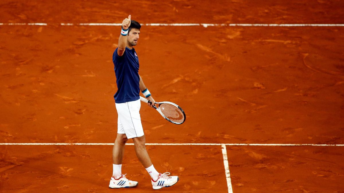 Serbian tennis player Novak Djokovic celebrates winning Spanish player Feliciano Lopez at the ATP Madrid Open in Madrid, on May 11, 2017.