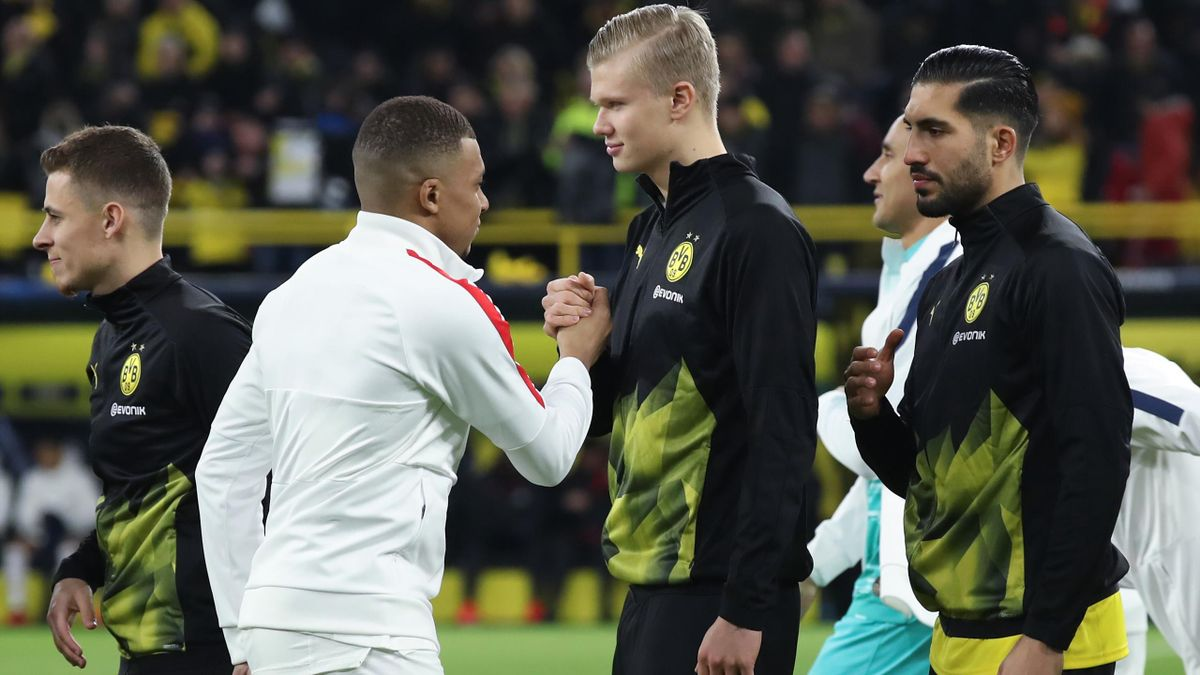 Kylian Mbappe of Paris Saint-Germain shakes hands with Erling Haaland of Dortmund prior to the UEFA Champions League round of 16 first leg match between Borussia Dortmund and Paris Saint-Germain at Signal Iduna Park on February 18, 2020 in Dortmund, Germa