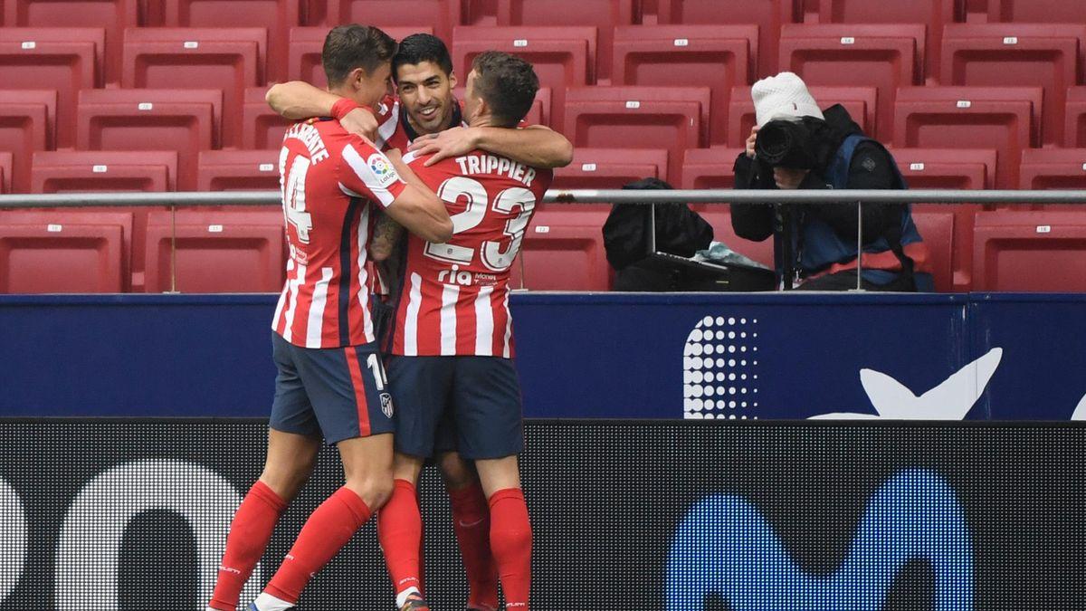 Marcos Llorente, Luis Suárez y Kieran Trippier (Atlético)