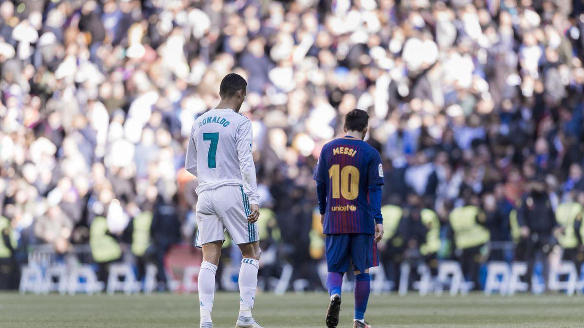 Cristiano Ronaldo și Leo Messi, în timpul unui meci dintre Real Madrid și Barcelona