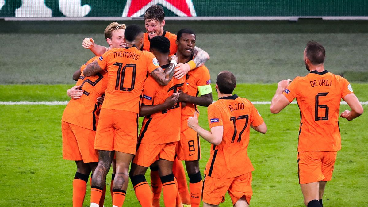AMSTERDAM - (lr) Memphis Depay of Holland, Wout Weghorst of Holland, Georginio Wijnaldum of Holland celebrate 2-0 during the UEFA EURO 2020 Group C match between the Netherlands and Ukraine at the Johan Cruijff ArenA on June 13, 202