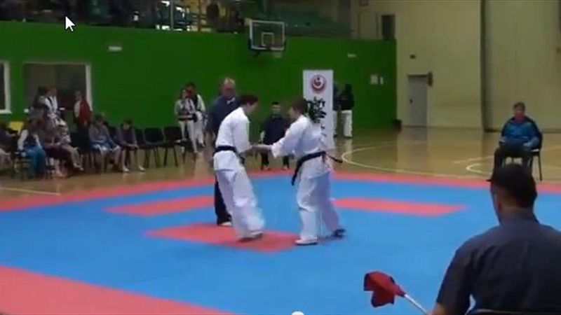 Karate girl knocks out opponent with flip kick