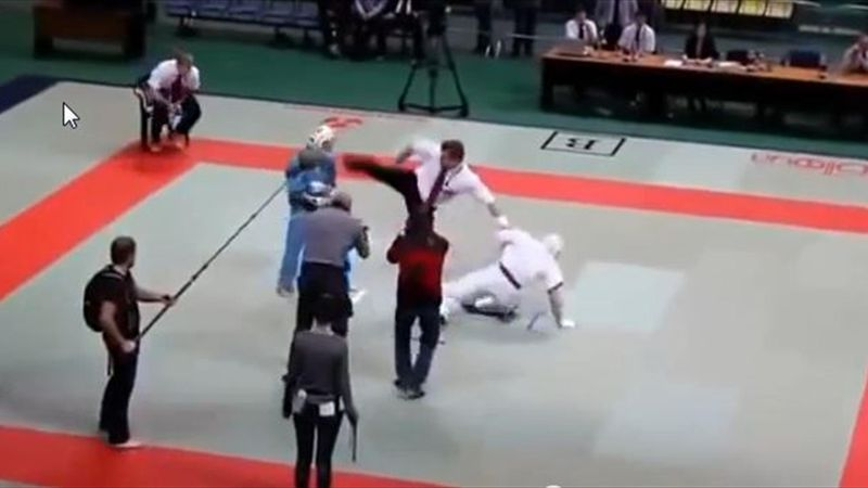 Martial arts ref goes bananas and floors both fighters
