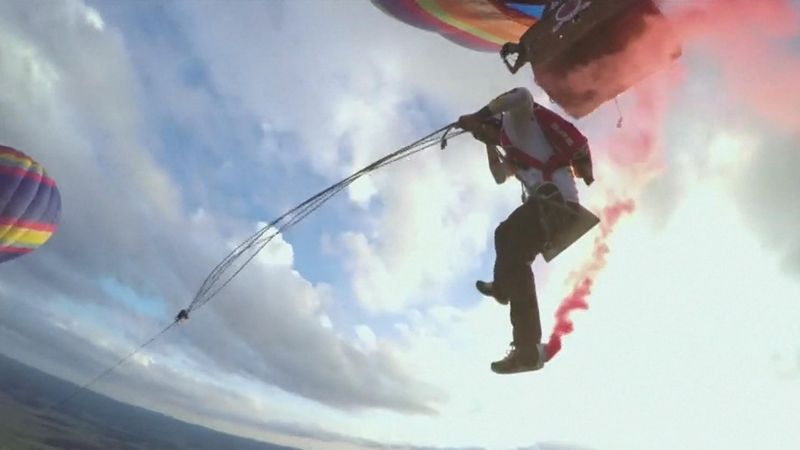 Skydivers plunge from two hot air balloons in bid to break biggest swing record