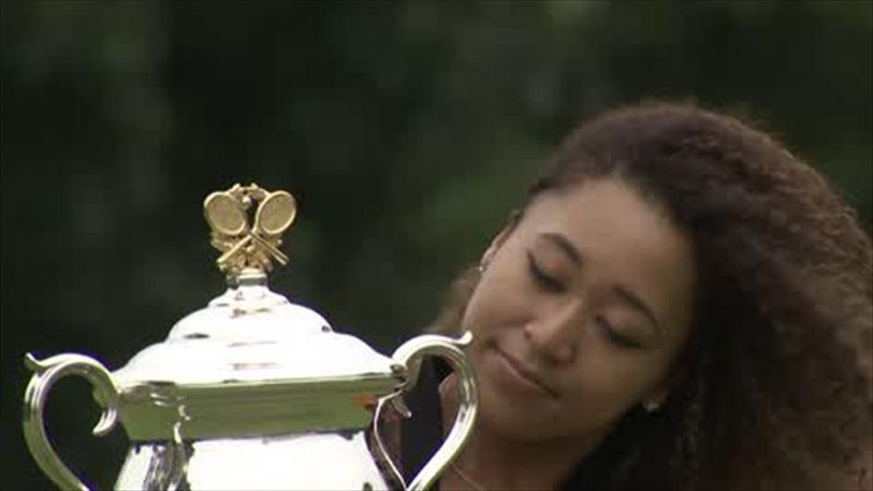 Osaka celebrates with trophy after second Melbourne crown