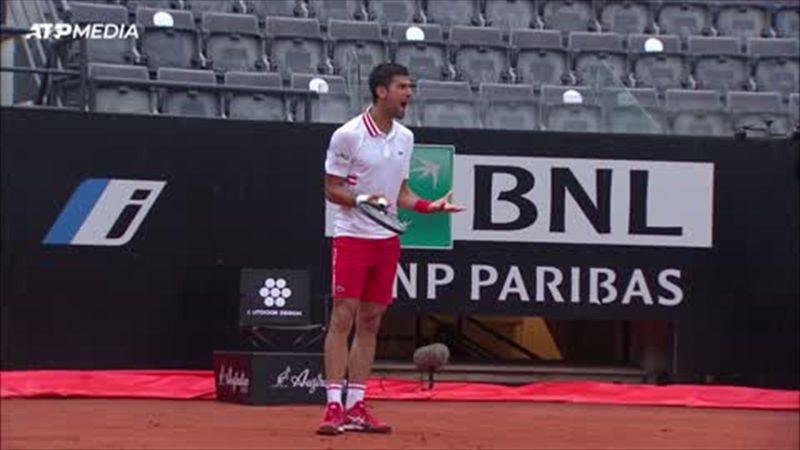 Soaked Djokovic explodes at umpire