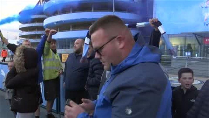 Man City fans celebrate title win outside Etihad