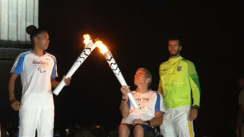 Paralympic torch stops to see Christ the Redeemer in Rio de Janeiro