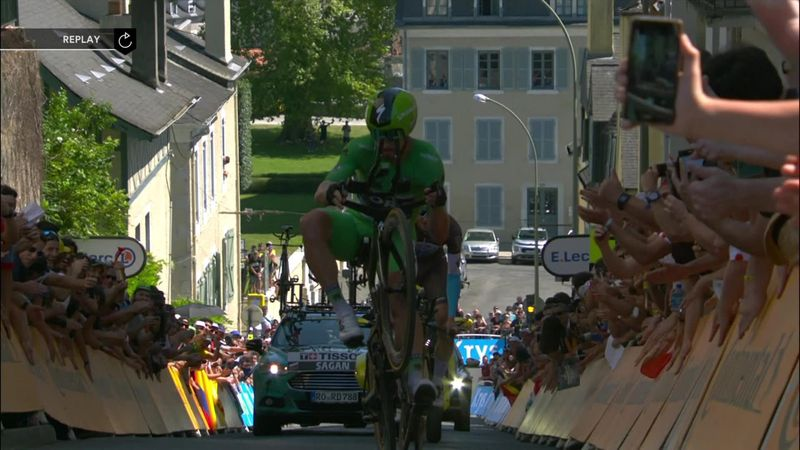 Peter Sagan does a one-handed wheelie up a 17% gradient