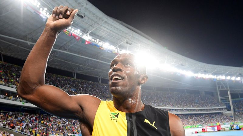 Bolt overawes Gatlin to win third straight 100m title in Rio